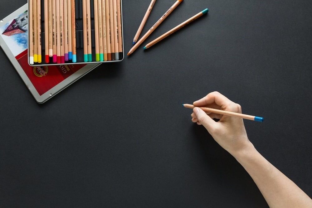person holding brown pencil