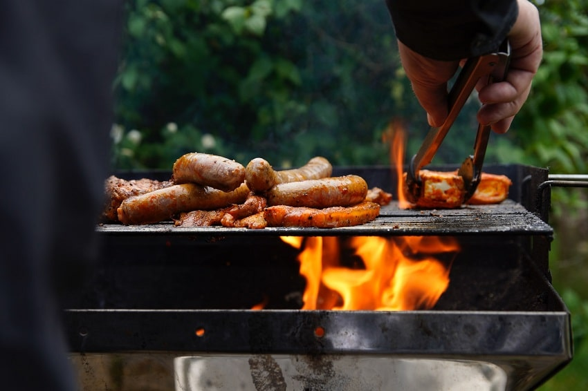 A picture containing person, grill, barbecue, dish  Description automatically generated